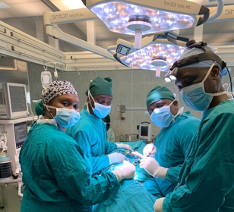 Dr. Cheserem, left, at work in Tanzania
